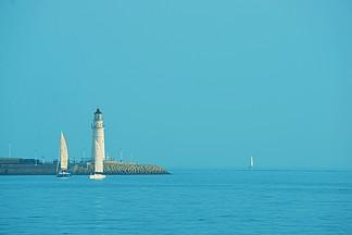 青島海洋白帆小清新藍色白塔帆船燈塔藍天