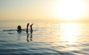 Woman swimming in salty water