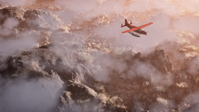 空中的红色飞机飞越灰岩山风景