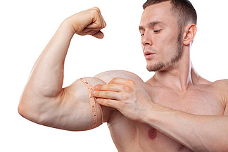 Image of muscular man measure his biceps with measuring tape in centimeters. Isolated on white <i>backg</i>