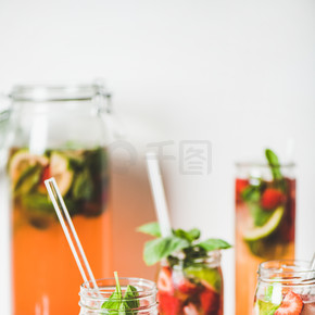 Homemade strawberry and basil lemonade or ice tea in glass tumblers with eco-friendly plastic-free s